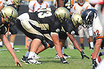 Palos Verdes, CA 09/22/11 - Luca Sartini (Peninsula #73)) in action during the Beverly Hills-Peninsula Varsitty Football gane.