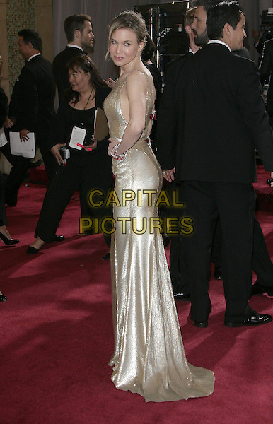 Renee Zellweger (wearing Carolina Herrera).85th Annual Academy Awards held at the Dolby Theatre at Hollywood & Highland Center, Hollywood, California, USA..February 24th, 2013.oscars full length gold sleeveless dress hand on hip side  .CAP/ADM.©AdMedia/Capital Pictures.