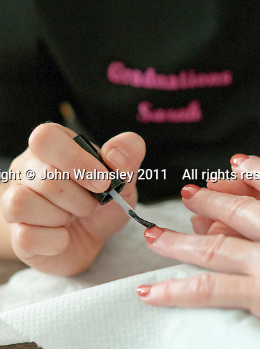 Painting fingernails, Beauty Department, Sussex Downs College, Lewes, East Sussex.
