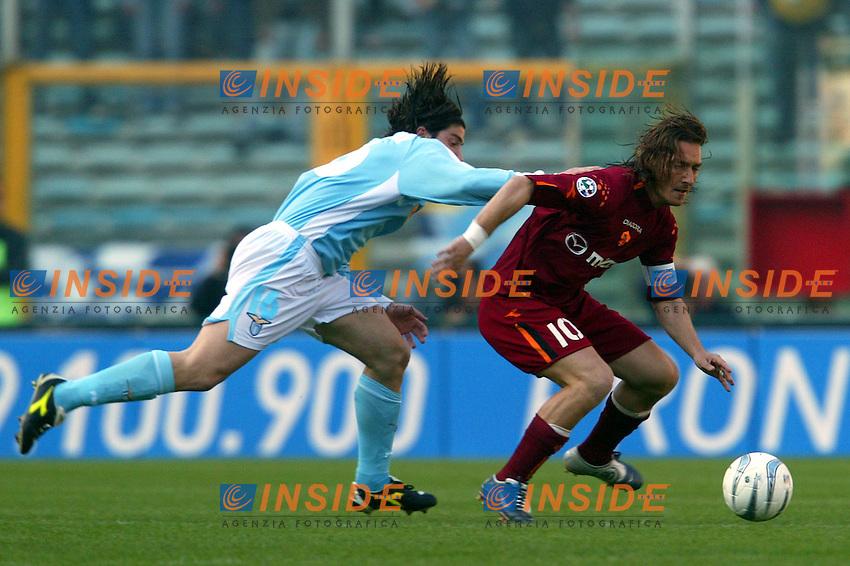Roma 21/4/2004 Campionato Italiano Serie A <br /> Lazio - Roma 1-1 <br /> Giuliano Giannichedda (Lazio) and Francesco Totti (Roma)<br /> Lazio and Roma are playing again after it was suspended on March 21, 2004, for security reasons.  <br /> Foto Andrea Staccioli Insidefoto