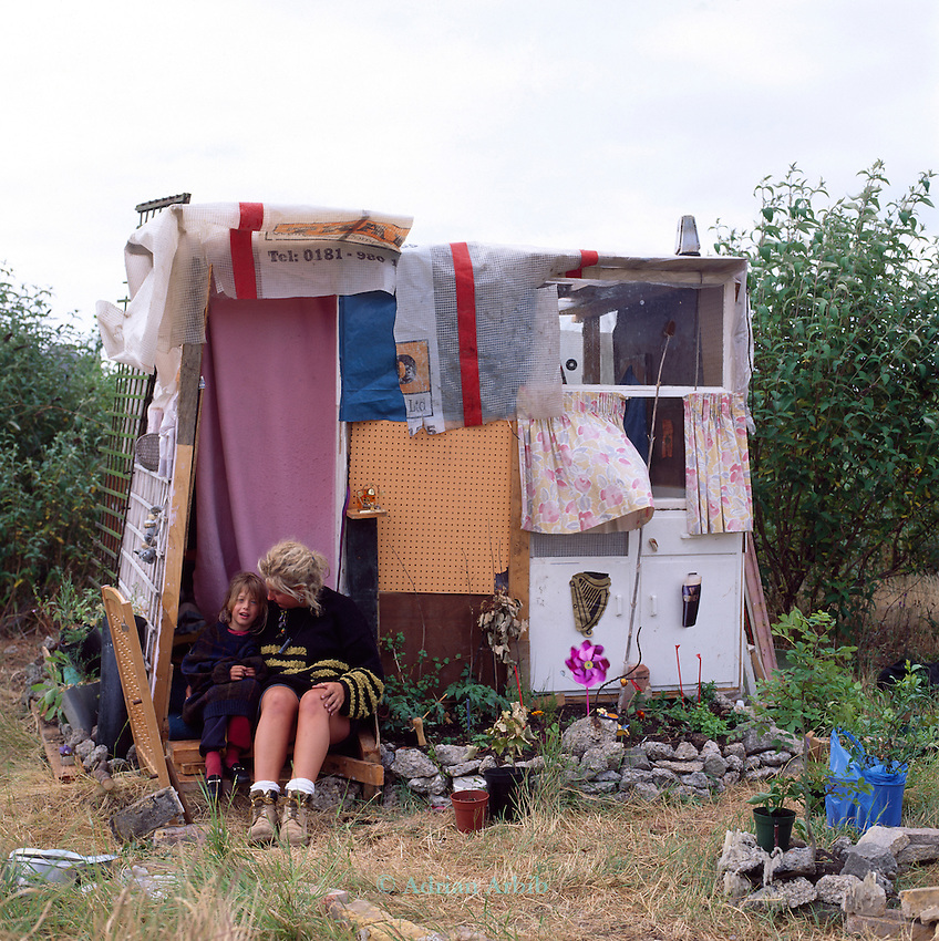Anne and her daughter and her homemade house on the site of the Wandsworth Eco village.