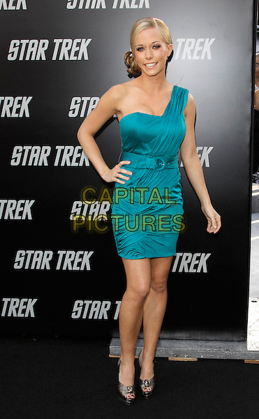 """KENDRA WILKINSON.The Paramount Pictures L.A. Premiere of """"Star Trek"""" held at The Grauman's Chinese Theatre in Hollywood, California, USA. .April 30th, 2009.full length one shoulder blue green teal dress silk satin hand on hip bronze peep toe shoes belt belted .CAP/DVS.©Debbie VanStory/Capital Pictures."""