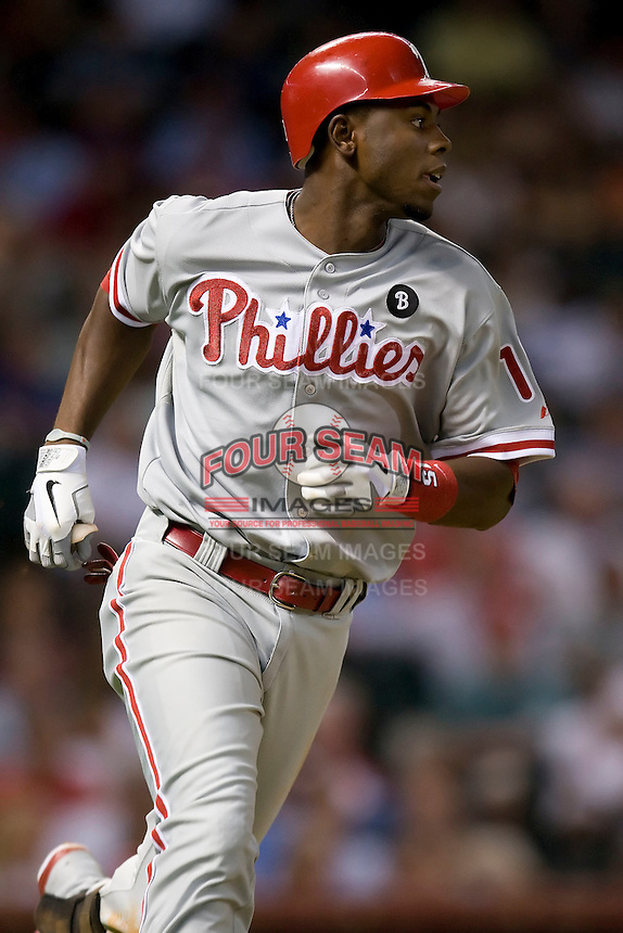 Philadelphia Phillies outfielder John Mayberry Jr #15 heads to first base during the Major League Baseball game against the Houston Astros at Minute Maid Park in Houston, Texas on September 13, 2011. Houston defeated Philadelphia 5-2.  (Andrew Woolley/Four Seam Images)