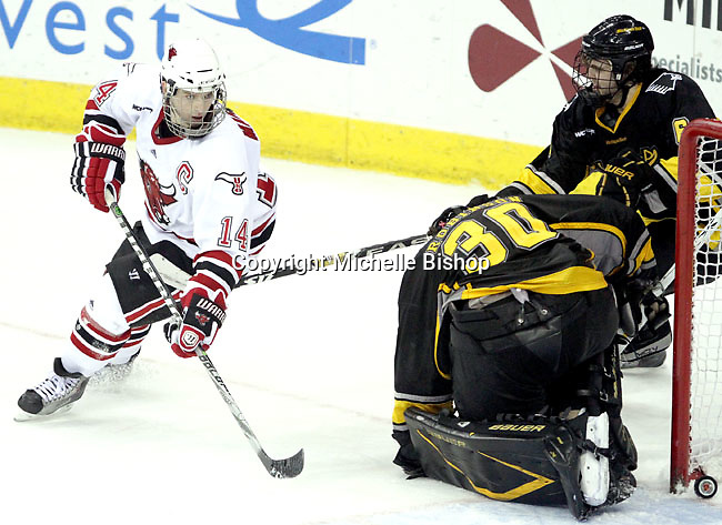 UNO's Joey Martin watches as the puck rolls into the net past Michigan Tech goalie Josh Robinson. Martin's third period goal capped the scoring for the Mavericks. UNO defeated Michigan Tech 5-2 Thursday night at Qwest Center Omaha. (Photo by Michelle Bishop)