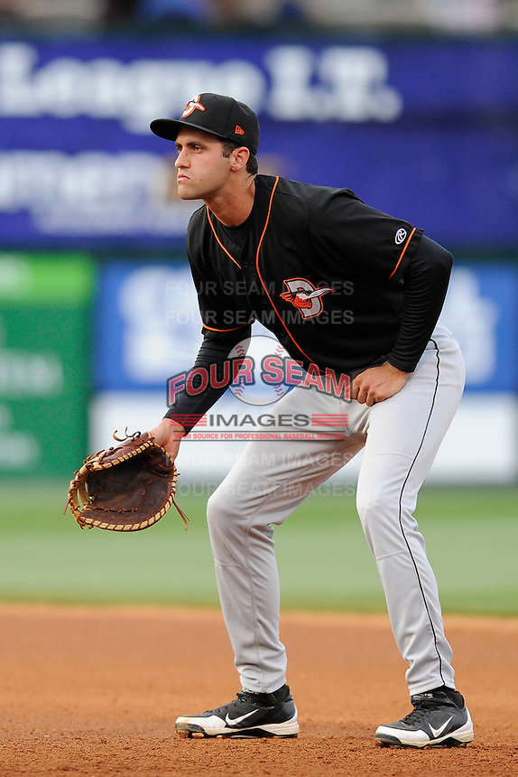Infielder Nik Balog (18) of the Delmarva Shorebirds in position at first base in a game against the Greenville Drive on Friday, April 26, 2013, at Fluor Field at the West End in Greenville, South Carolina. Delmarva won, 10-3. (Tom Priddy/Four Seam Images)