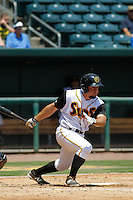 Jacksonville Suns infielder Zach Cox (20) in action during a game against the Pensacola Blue Wahoos at Bragan Field on the Baseball Grounds of Jacksonville on May 11, 2015 in Jacksonville, Florida. Jacksonville  defeated Pensacola 5-4. (Robert Gurganus/Four Seam Images)
