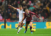 9th November 2019; Wembley Stadium, London, England; International Womens Football Friendly, England women versus Germany women; Sara Dabritz of Germany competes for the ball with Nikita Parris of England - Editorial Use