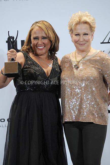 WWW.ACEPIXS.COM . . . . . .March 14, 2011...New York City...Darlene Love and Bette Midler in the press room at the 26th annual Rock and Roll Hall of Fame Induction Ceremony at The Waldorf Astoria on March 14, 2011 in New York City.....Please byline: KRISTIN CALLAHAN - ACEPIXS.COM.. . . . . . ..Ace Pictures, Inc: ..tel: (212) 243 8787 or (646) 769 0430..e-mail: info@acepixs.com..web: http://www.acepixs.com .