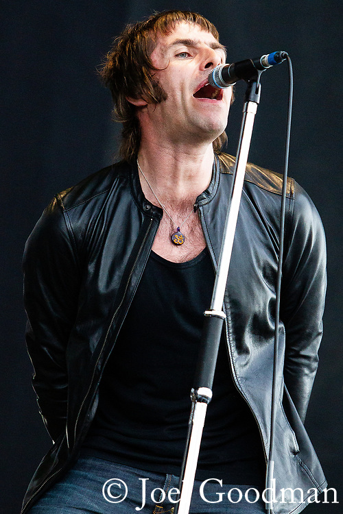 © Joel Goodman - 07973 332324 . 30/06/2012 . Manchester , UK . Beady Eye , fronted by LIAM GALLAGHER , performs on stage ahead of the Stone Roses . Stone Roses Second Coming reunion gig at Heaton park in North Manchester . Photo credit : Joel Goodman