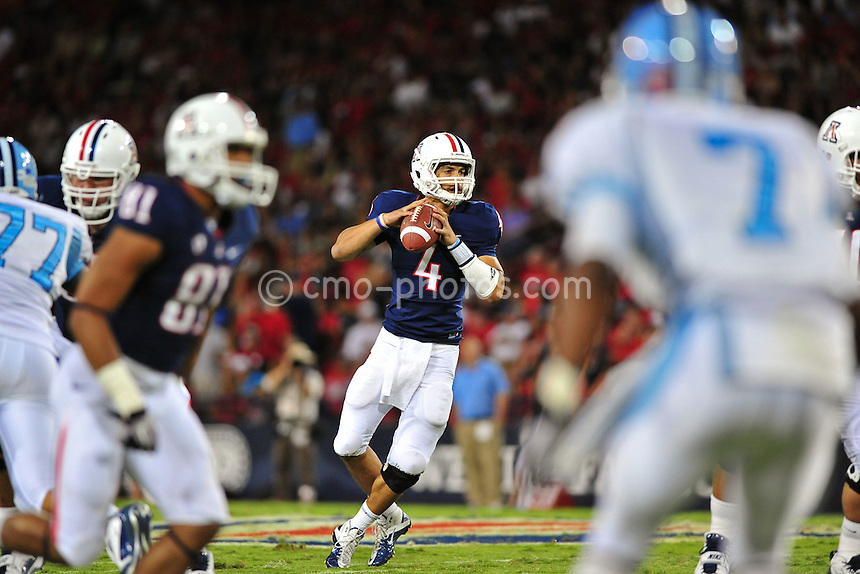 Sept 11, 2010; Tucson, AZ, USA; Arizona Wildcats quarterback Matt Scott (4) drops back to pass in the 2nd quarter of a game against the Citadel Bulldogs at Arizona Stadium. Arizona won the game 52-6.