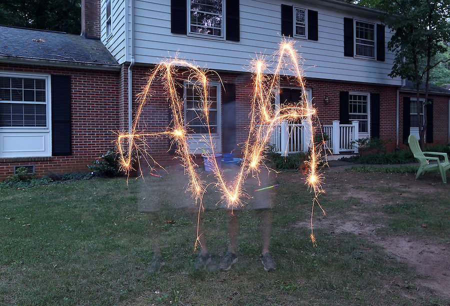 Ava and Andrew with sparklers in front yard at home in Albemarle County, Va. Photo/Andrew Shurtleff