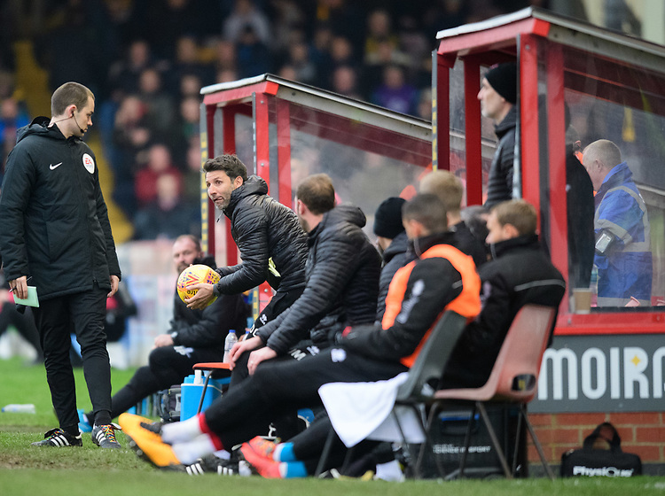 Lincoln City manager Danny Cowley attempts to get the ball back in play quickly<br /> <br /> Photographer Chris Vaughan/CameraSport<br /> <br /> The EFL Sky Bet League Two - Lincoln City v Mansfield Town - Saturday 24th November 2018 - Sincil Bank - Lincoln<br /> <br /> World Copyright © 2018 CameraSport. All rights reserved. 43 Linden Ave. Countesthorpe. Leicester. England. LE8 5PG - Tel: +44 (0) 116 277 4147 - admin@camerasport.com - www.camerasport.com