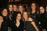 Group pose of Italian and Spanish teams with (Middle L-R) rhythmic gymnasts from Spain are Carolina Rodriquez, Esther Escolar, Almudena Cid during banquet after World Championships at Baku, Azerbaijan on October 9, 2005.  (Photo by Tom Theobald)