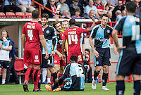 Luke Rooney of Crawley Town receives a yellow card after 1 minute of coming on during the Sky Bet League 2 match between Crawley Town and Wycombe Wanderers at Checkatrade.com Stadium, Crawley, England on 29 August 2015. Photo by Liam McAvoy.