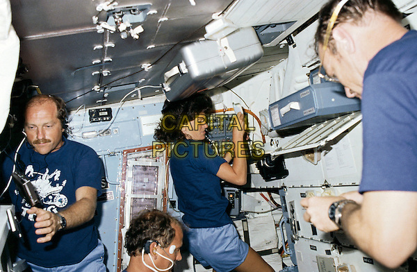Astronaut Sally K. Ride, STS-7 mission specialist, communicates with ground controllers from the flight deck of the Earth-orbiting Space Shuttle Challenger on June 21, 1983.  Dr. Ride passed away due to Pancreatic Cancer on Monday, July 23, 2012.  .half length blue t-shirt .CAP/ADM/NASA/RS.©Sach/NASA/AdMedia/Capital Pictures