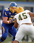 BROOKINGS, SD - SEPTEMBER 14:  Mike Shoff # 63 from South Dakota State University throws a block on A.J. Bowen #45 from Southeastern Louisiana in the second quarter of their game Saturday night at Coughlin Alumni Stadium in Brookings. (Photo by Dave Eggen/Inertia)
