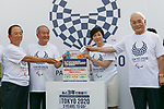 Tokyo governor Yuriko Koike (C) and organizers drop old phones on a recycling box for medals during the 3 Years to Go! ceremony for the Tokyo 2020 Paralympic games at Urban Dock LaLaport Toyosu on August 25, 2017. The Games are set to start on August 25th 2020. (Photo by Rodrigo Reyes Marin/AFLO)