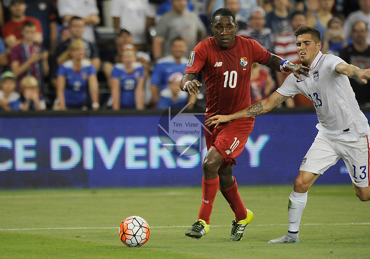 Panama Luis Tejada (10) and USA Ventura Alvarado (13) battle for the ball in the first half. Panama tied the USA 1-1 in a Group A game during the Gold Cup 2015 at Sporting Park in Kansas City, Kansas on Monday July 13, 2015.