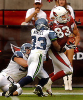 Nov. 6, 2005; Tempe, AZ, USA; Tight end (83) Eric Edwards of the Arizona Cardinals avoids a tackle from safety (33) Marquand Manuel of the Seattle Seahawks at Sun Devil Stadium. Mandatory Credit: Mark J. Rebilas