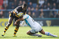Christian Wade of London Wasps is tackled by Josh Matavesi of Worcester Warriors during the Aviva Premiership match between London Wasps and Worcester Warriors at Adams Park on Sunday 7th October 2012 (Photo by Rob Munro)