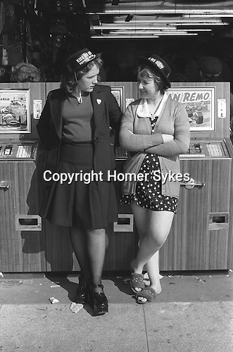 Blackpool 1974, girls on holiday wearing Kiss Me Quick, Squeeze Me Slow. 1970s working class Britain.