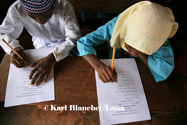 Pupils from the Islamic school in Sunyani, Ghana, working on their exam. In Ghana, coranic schools were transformed into islamic schools. Pupils learn the mainstream curriculum and have additional courses in arabic and islam.