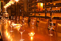 A wine tasting room with glasses on the table and lit candles. Wine racks with old wine bottles in the background. Golden light. Ulriksdal Ulriksdals Wärdshus Värdshus Wardshus Vardshus Restaurant, Stockholm, Sweden, Sverige, Europe