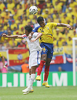 Costa Rica's Walter Centeno (left) and Ecuador's Luis Valencia (16) go up for a header. Ecuador defeated Costa Rica 3-0 in their FIFA World Cup Group A match at FIFA World Cup Stadium, Hamburg, Germany, June 15, 2006.