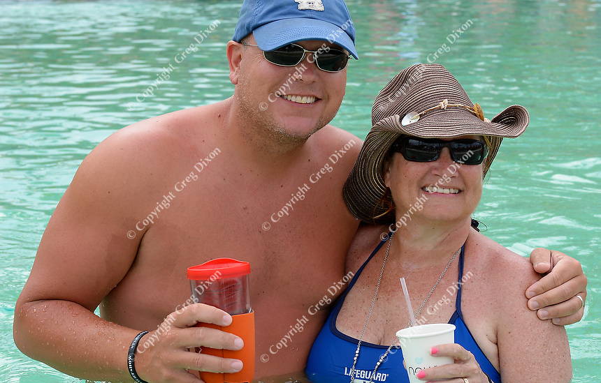 Jared's brother, Matt, and aunt, Nancy Moss, pose in the pool on Wednesday, two days before Allison & Jared's wedding in Punta Cana