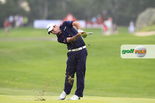 Gary Stal (FRA) plays his 2nd shot on the 13th hole during Sunday's Final Round of the Abu Dhabi HSBC Golf Championship 2015 held at the Abu Dhabi Golf Course, United Arab Emirates. 18th January 2015.<br /> Picture: Eoin Clarke www.golffile.ie