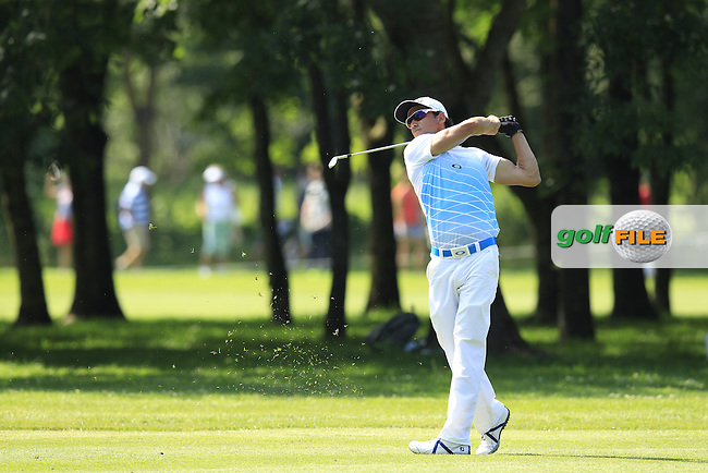 Rafael Cabrera-Bello (ESP) plays his 2nd shot on the 10th hole during Thursday's Round 1 of the 2013 BMW International Open held on the Eichenried Golf Club, Munich, Germany. 20th June 2013<br /> (Picture: Eoin Clarke www.golffile.ie)
