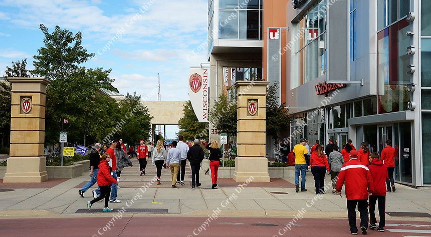 People walk through the University of Wisconsin East Campus Mall on Saturday, October 3, 2015 in Madison, Wisconsin