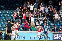 Billy Waters of Cheltenham Town celebrates making it 3 all in front of the travelling fans during the Sky Bet League 2 match between Wycombe Wanderers and Cheltenham Town at Adams Park, High Wycombe, England on the 8th April 2017. Photo by Liam McAvoy.
