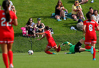 BOYDS, MD - May 26 2014: Erin McLeod of Houston trips Jodie Taylor resulting in a penalty kick for the Spirit during Washington Spirit v Houston Dash NWSL match at Maryland Sportsplex, in Boyds, Maryland. Spirit won 3-2.