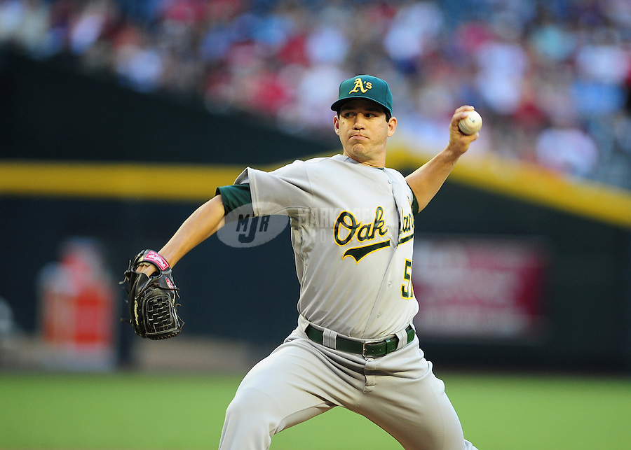 Jun. 8, 2012; Phoenix, AZ, USA; Oakland Athletics pitcher Tommy Milone throws in the first inning against the Arizona Diamondbacks at Chase Field.  Mandatory Credit: Mark J. Rebilas-