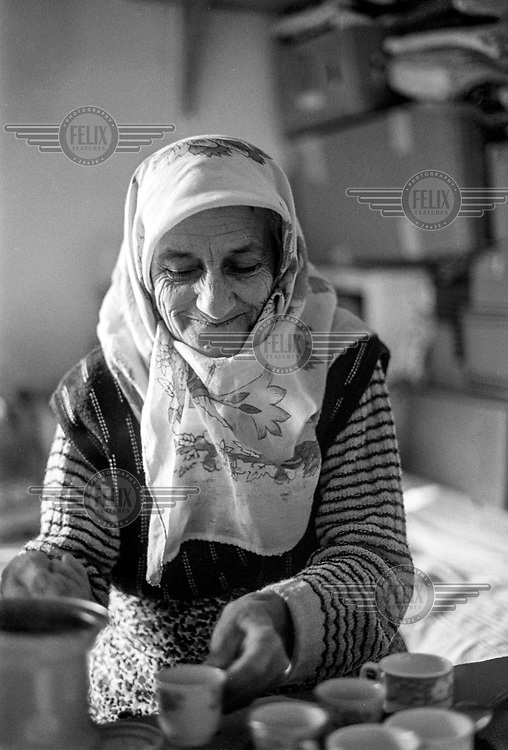 'Nana' (grandmother), a Bosnian matriarch, making endless cups of Turkish coffee at the Varazdin refugee camp in the winter of 1992. <br /> <br /> In 1992 while volunteering at the Varazdin refugee camp Panos photographer Bjoern Steinz met and became close to Elvis, a Bosnian Muslim refugee, and his family. They shared the hardships of camp life together which Steinz documented. While the prints were archived for many years two of the images always returned to Bjoern's thoughts. 25 years later he set out to try and find out what had happened to Elvis and his family in the intervening years. Modern social media made the task surprisingly easy and they were reunited in Hadzici where Elvis now lives with his family.