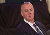 United States Secretary of the interior Ryan Zinke listens as US President Donald J. Trump hosts the 2018 White House Business Session with  Governors, February 26, 2018, at The White House in Washington, DC. <br /> Photo by Chris Kleponis/ CNP