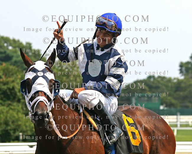 Jockey Paco Lopez scored his 1,000th career victory aboard Whitey's Gold in the 2nd race at Monmouth Park on Friday August 17, 2012.  Photo by Bill Denver/EQUI-PHOTO
