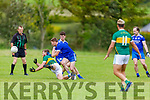 Shane O'Connell of Knocknagoshel passes the ball as he is under pressure from Shane Foley of Annascaul in the Kerry Junior Club Championship round 1 game on Sunday.