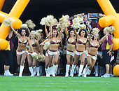 Washington Redskins cheerleaders run onto the field to perform prior to the preseason game against the Baltimore Ravens at FedEx Field in Landover, Maryland on Saturday, August 21, 2010.  The Ravens won the game 23 - 3..Credit: Ron Sachs / CNP