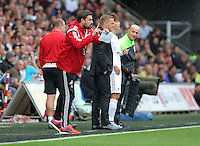 Pictured L-R: Josep Pep Clotet gives instructions to the players, standing next to manager Garry Monk Sunday 30 August 2015<br /> Re: Premier League, Swansea v Manchester United at the Liberty Stadium, Swansea, UK