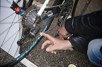 2013 Giro d'Italia.stage 12.Longarone - Treviso: 134km..putting some grease on the chain to protect against the very wet elements ahead