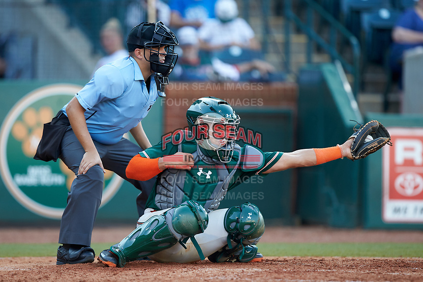 Greensboro Grasshoppers catcher Will Banfield (18) reaches for a pitch as home plate umpire Josh Gilreath looks on during the game against the West Virginia Power at First National Bank Field on August 9, 2018 in Greensboro, North Carolina. The Power defeated the Grasshoppers 5-3 in game one of a double-header. (Brian Westerholt/Four Seam Images)