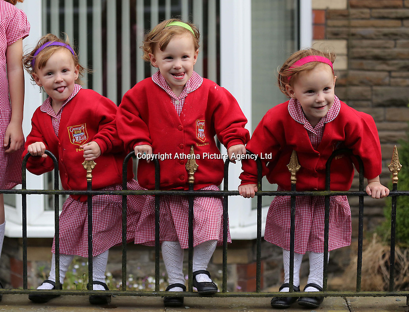 Pictured L-R: Paige, Maddison and Ffion Gilbert <br /> Re: A set of identical triplets have been colour-coded to help teachers tell them apart on their first day in nursery school.<br /> Three-year-olds Ffion, Maddison and Paige Gilbert, are so alike even their parents struggle to know which is which.<br /> Karen and Ian Gilbert used different coloured nail-varnish on their fingers and toes to identify them when they were babies.<br /> Now the couple are using the same colours for their hair bands and bobbles at the nursery where they have just enrolled.<br /> And the colours even correspond with the names of the identical trio. <br /> Ffion has fuschia, Maddison has mint and Paige has purple.<br /> Karen, 35, of Pontypool, South Wales, said: &quot;We have colour-coded them since they were tiny babies - it helped us keep track of which ones had been fed.<br /> &quot;But nail varnish isn't allowed in school so we had come up with come other way.