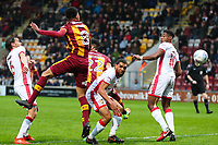 Tim Dieng of Bradford City scores to make it 1-0 during the Sky Bet League 1 match between Bradford City and MK Dons at the Northern Commercial Stadium, Bradford, England on 24 April 2018. Photo by Thomas Gadd.