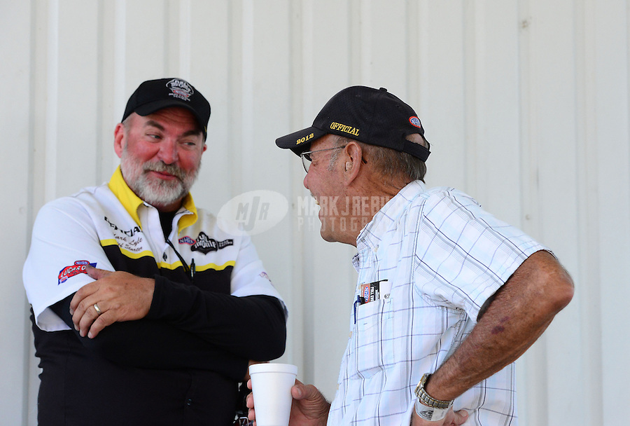 Sept. 23, 2012; Ennis, TX, USA: NHRA retired official starter Rick Stewart (right) talks with current official starter Mark Lyle during the Fall Nationals at the Texas Motorplex. Mandatory Credit: Mark J. Rebilas-