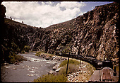 Train which consist of tank cars, stock cars, gondolas and box cars entering Black Canyon.<br /> D&amp;RGW  Black Canyon, CO