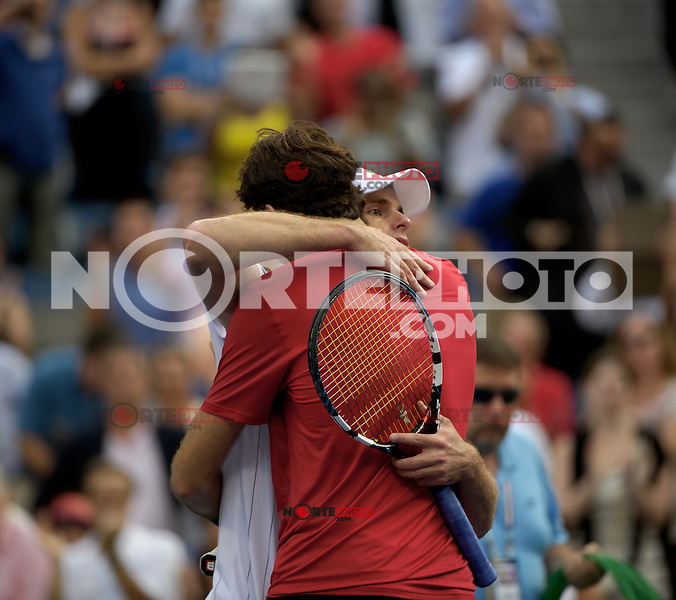 September 5, 2012: In recognition of his retirement, Andy Roddick [L] (USA) is embraced by Juan Martin Del Potro (ARG) after his loss during their quarterfinal Men's Singles match on Day 10 of the 2012 U.S. Open Tennis Championships at the USTA Billie Jean King National Tennis Center in Flushing, Queens, New York, USA. Credit: mpi105/MediaPunch Inc.