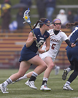 University of New Hampshire midfielder Kate Keagins (6) on the attack as Boston College defender Kate Collins (6) defends. Boston College defeated University of New Hampshire, 11-6, at Newton Campus Field, May 1, 2012.
