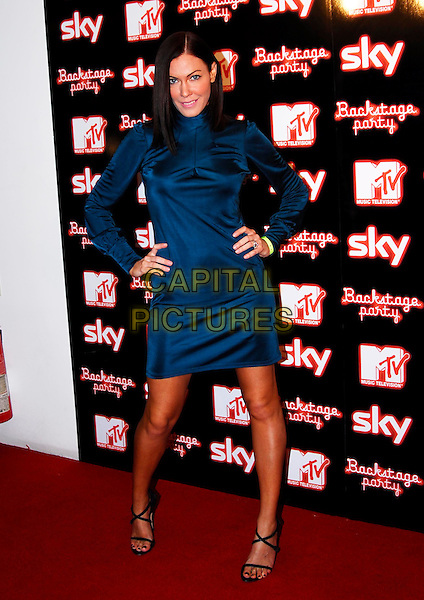 LINZI STOPPARD.MTV European Music Awards - Backstage Party, Sound, Leicester Square, London, UK..November 2nd, 2006.Ref: IA.full length blue dress hands on hips.www.capitalpictures.com.sales@capitalpictures.com.©Ian Allis/Capital Pictures